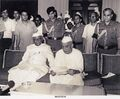 1979-07-20 Ch. Charan Singh reading letter given to him by Pesident N Sanjeeva Reddy to form government - NA33153.jpg